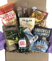 Contains:<ul> <li>Tod's Smoked Chipotle vegan jerky</li><li>Mr. G's gourmet kettle corn</li><li>Sweetgrass Kentucky harvest granola</li><li>Laura's Chocolate Hemp candy</li><li>Blue Monday candy bar</li><li>Ale-8-One soft drink</li><li>Old Kentucky Chocol